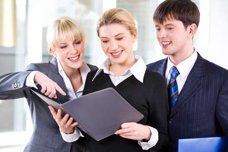 Portrait of confident people discussing a project at business meeting photo