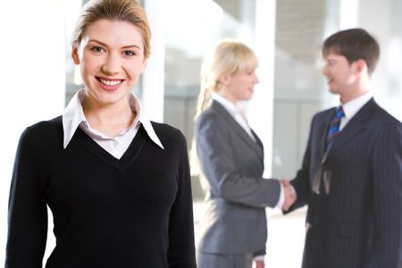 Portrait of beautiful woman on the background of people shaking hands  photo