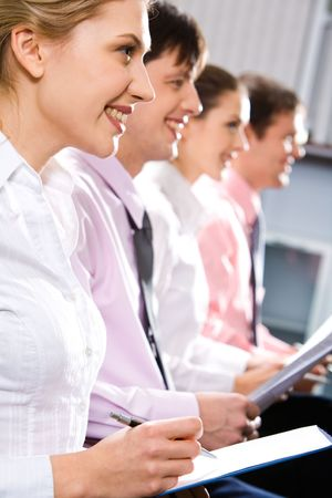 Portrait of four mature students listening to a teacher at seminar Stock Photo - 2432980