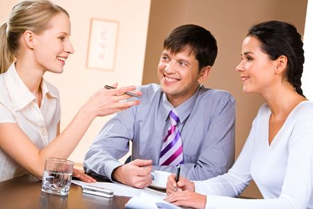Business people gathered together around the table and discussing working questions Stock Photo - 2455705