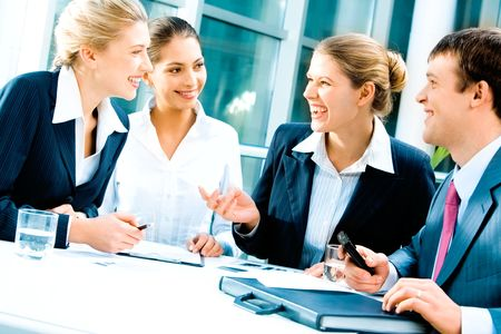 workplace: Image of laughing confident people planning a business-strategy