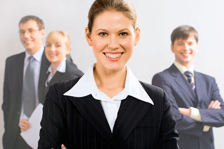 Portrait of attractive leader with her business team in the background Stock Photo - 2464875