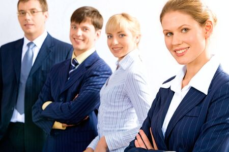 Portrait of business team in row with female leader in front Stock Photo - 2464881