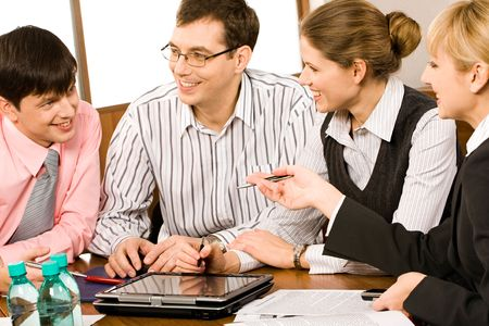 Portrait of business people sitting at the table and discussing a new project Stock Photo - 2464887