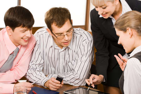 Business woman is explaining her business-plan to his colleagues pointing at laptop Stock Photo - 2464882