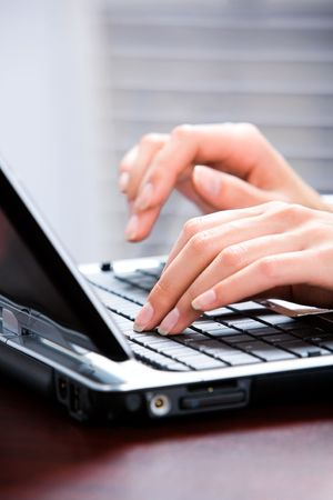 Image of hands typing a letter on the keyboard of laptop Stock Photo - 2464869