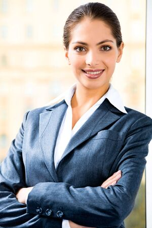 Portrait of attractive business woman in suit folding her arms Stock Photo - 2474935