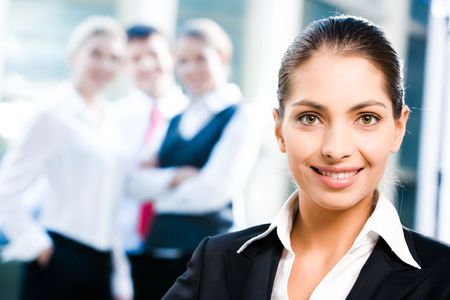 Face of female leader on the background of her business team Stock Photo