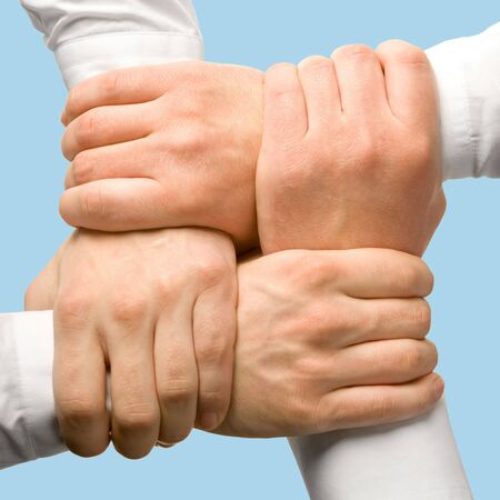 Photo of business people�s hands touching each other  photo