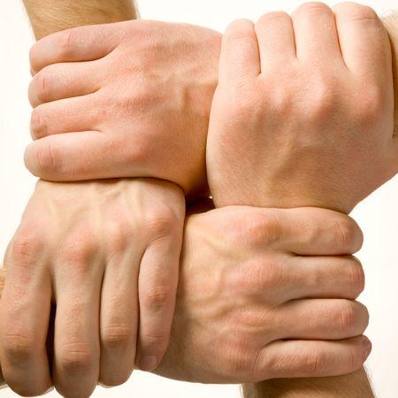 la union hace la fuerza: Close-up de las manos del hombre toc�ndose unas con otras m�s de fondo blanco Foto de archivo