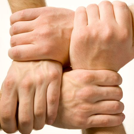 Close-up of human hands touching each other over white background