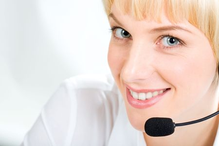 Portrait of friendly Customer Support Representative with marvelous eyes on a white background photo