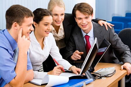 Portrait of business people looking at a monitor and discussing ideas Stock Photo - 2494854