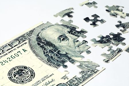 hoard: Image of dollar made of puzzles over white background Stock Photo