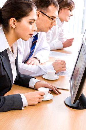 Portrait of mature students gazing at their monitors and reading important tasks Stock Photo - 2507037