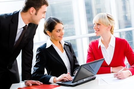 Portrait of business people looking at woman at working meeting Stock Photo - 2513173