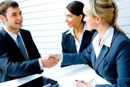 necessary: Successful people shaking hands making a necessary agreement