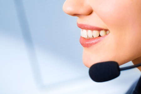 Image of mouth of consultant with smile isolated on a blue background Stock Photo - 2513147