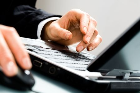 Image of human hands doing some computer work  Stock Photo - 2513152