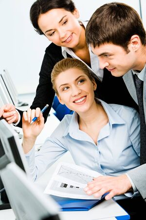 Portrait of three business people working together in the classroom Stock Photo - 2576341