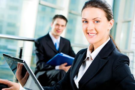 Confident business woman looking at camera during her computer work Stock Photo - 2576262