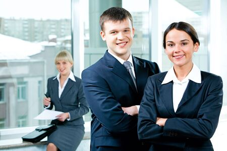 Portrait of two business people folding one's arms in the office Stock Photo - 2576263