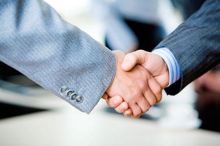 great job: Close-up of two businessmen�s handshake