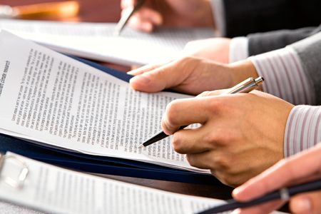 Image of peoples hands making notes in lecture  photo
