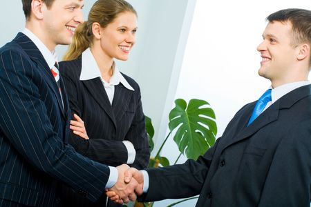 meet and greet: Handshake of two successful partners at business meeting