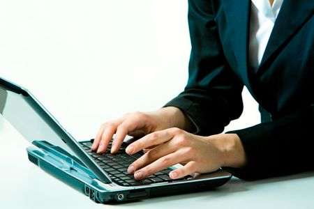 Image of business woman working on the laptop on a white background  Stock Photo