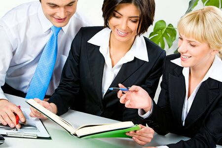 Portrait of three business people planning their work in the office Stock Photo - 2619964