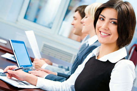 briefing: Portrait of smiling business woman looking at camera during working briefing  Stock Photo