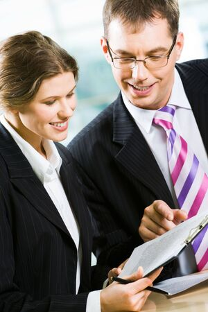 Vertical image of business partners working in the office together photo