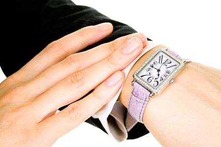 show time: Closeup of businesslady�s hand with a watch on it
