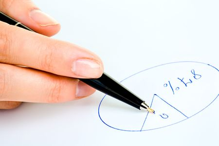 per cent: Closeup of human hand holding a pen and drawing a round diagram on paper Stock Photo