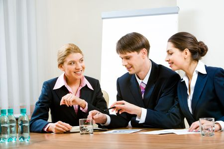 Portrait of three specialists discussing new ideas in the conference room  photo