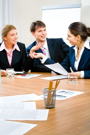 Image of three business people sitting at the table and discussing a new plan Stock Photo - 2634728