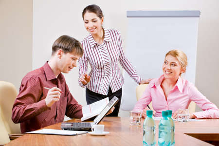 Image of several business people working in the office  photo