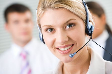 Face of young charming confident woman with headset Stock Photo