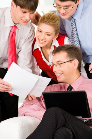 Business man showing an important document to his co-workers photo