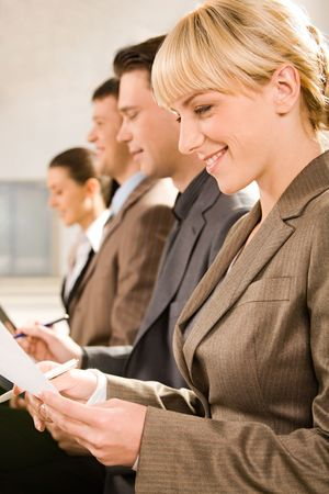Row of four business people studing a document at seminar Stock Photo - 2644956