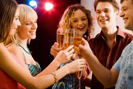 newyear night: Portrait of five happy people holding glasses of champagne making a toast Stock Photo