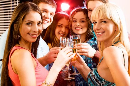 newyear night: Portrait of group of smiling young people enjoying cocktails  Stock Photo