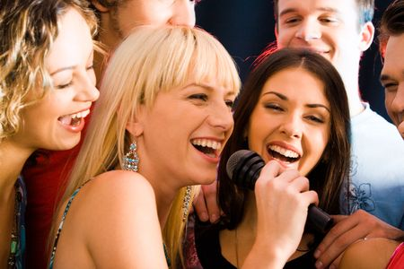 Portrait of three young attractive women singing together  Stock Photo - 2644753