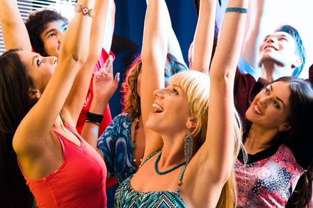 Happy young people lift up the hands at a party Stock Photo - 2644783