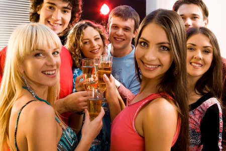 Portrait of seven friends holding glasses of champagne  Stock Photo - 2644774