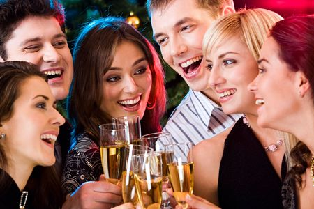 Portrait of happy young friends touching the glasses with each other Stock Photo - 2644766