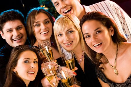 Portrait of several friends raising up their glasses Stock Photo - 2644780