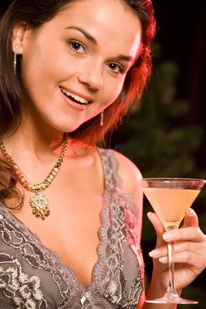 Portrait of wonderful woman holding her alcoholic drink photo