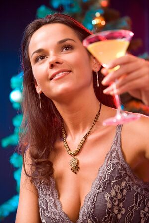 Portrait of  mysterious woman raising up her glass Stock Photo - 2644769